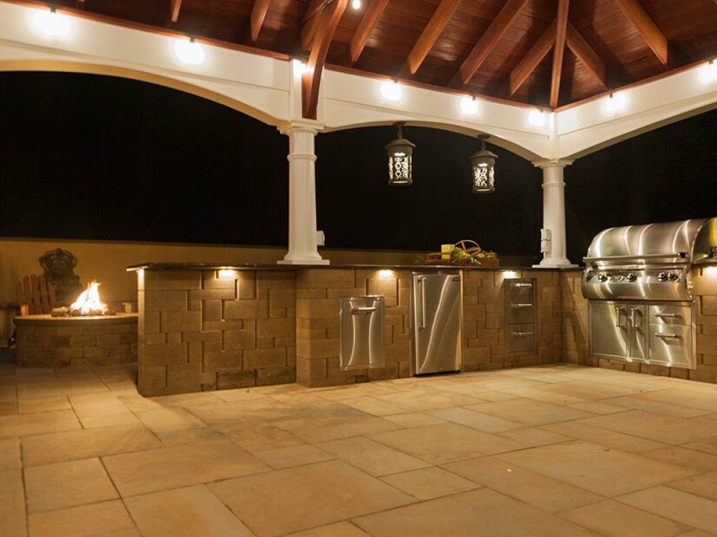 stone outdoor kitchen on patio