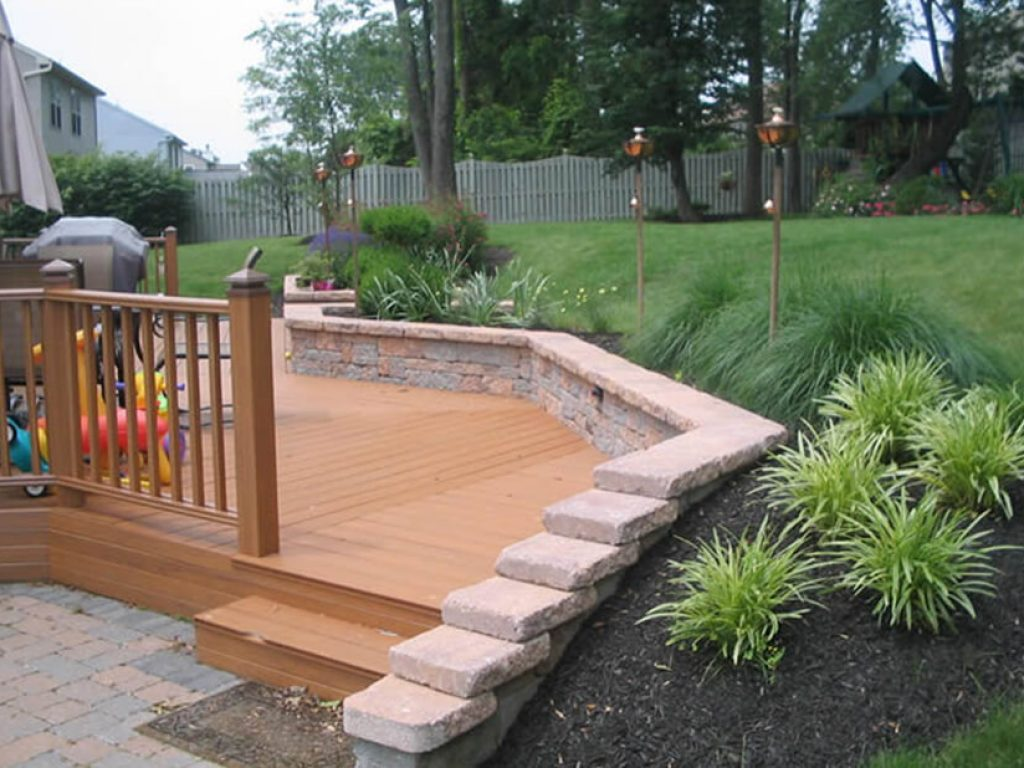 new deck surrounded by stone sitting wall