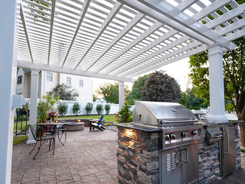 vinyl pergola over stone outdoor kitchen