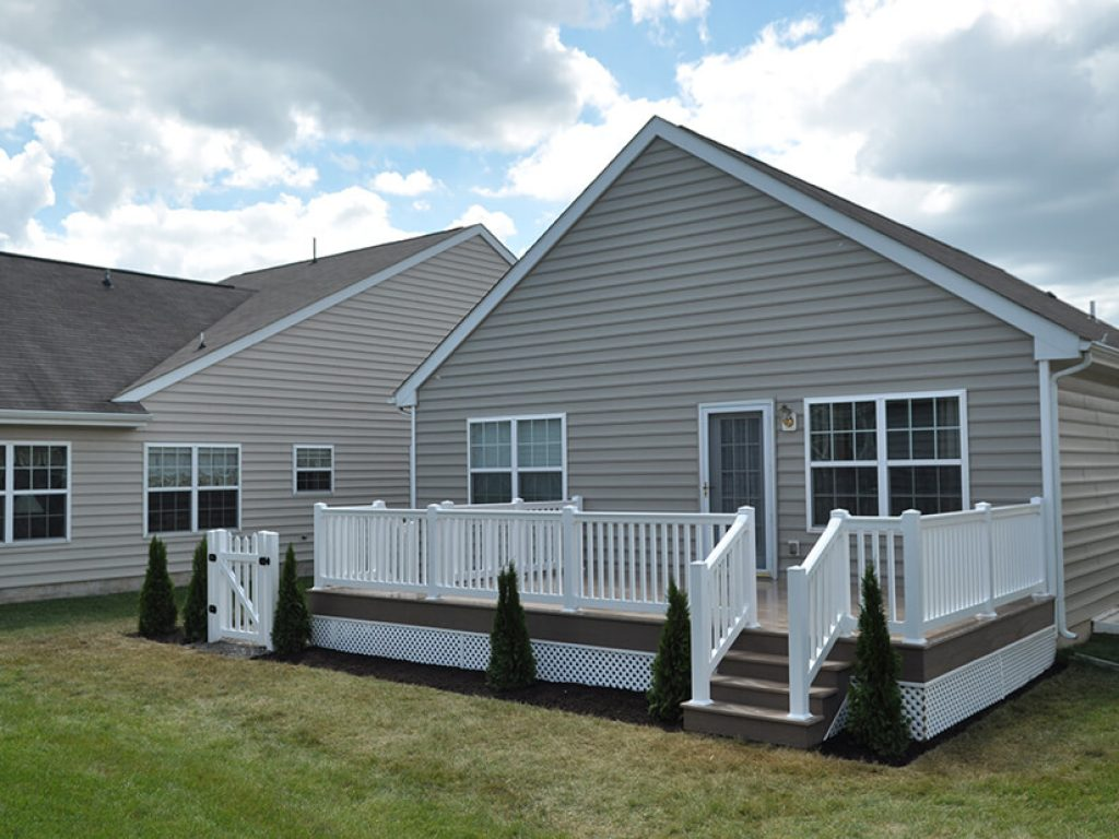 attached deck with white vinyl railing